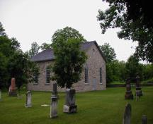 Corner view of the Old Stone Church, showing parts of the cemetery and wall, 2006.; Parks Canada Agency / Agence Parcs Canada, 2006.