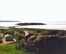 General view of Partridge Island Quarantine Station, showing the isolated location of Partridge Island at the mouth of Saint John Harbour.; Parks Canada Agency / Agence Parcs Canada, 2003.