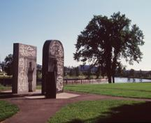 General view of Cartier-Brébeuf, showing a monument and a view of the Saint Charles River.; Parks Canada Agency / Agence Parcs Canada.