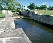 General view of Carillon Canal, showing the old south stone wall, 1999.; Parks Canada Agency / Agence Parcs Canada, Bergeron J.F, 1999.