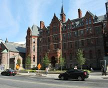 General view of Royal Conservatory of Music, showing the balanced, four-storey massing and detailing that exhibits High Victorian Gothic Revival, Queen Anne Revival and Romanesque elements, 2010.; Royal Conservatory of Music, Joseph A, August 2010.