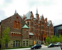 General view of Royal Conservatory of Music, showing the projecting bays, arched windows, pronounced stringcourses and lively roofline, 2011.; Royal Conservatory of Music, Canuckistan, May 2011.