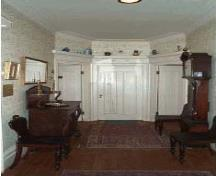 General view of the main entrance hall, inside the Henry-Stuart House.; Parks Canada Agency/Agence Parcs Canada, C. Desmeules.