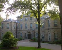 General view of Government House, showing the Palladian-inspired design of the house, with its central three-storey pavilion under a low hipped roof, 2010.; Government House, Jimmy Emerson, 2010.