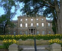 Rear view of Government House, showing the reduction in window height on each storey with rusticated arched openings on the ground floor.; Government House, Jimmy Emerson, 2010.