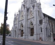 General view of St. Mary's Basilica, showing its imposing, stone construction, which reflects its importance as a cornerstone of the Roman Catholic community in Nova-Scotia, 2006.; Parks Canada Agency / Agence Parcs Canada, 2006.
