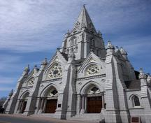 General view of St. Mary's Basilica, showing the High Victorian Gothic Revival style facade with its elaborate triple portal and central tower with dressed granite spire, 2009.; St. Mary's Basilica, Glenn Euloth, 2009.