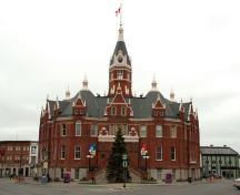 General view of Stratford City Hall, showing its siting on an irregular, triangular-shaped site, and its central location, 2011.; Stratford City Hall, Perry Quan, 2011.