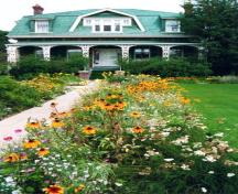 View of front of Jesse Ashbridge House and gardens, 1990s; OHT
