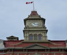 Detail view of Victoria City Hall, showing the central clock tower, 2011.; Parks Canada Agency / Agence Parcs Canada, Andrew Waldron, 2011.