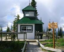 Front view of the building, from the west, showing exterior covering of wooden shingles and clapboard, surmounted by a smaller square cupola, with windows.; Parks Canada Agency/Agence Parcs Canada , 2011
