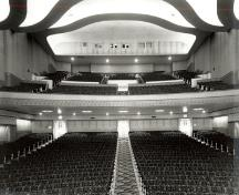 Interior view of Vogue Theatre, showing the streamlined Moderne design of the interior, evident in the sinuous, sweeping curves of the auditorium.; Vancouver Public Library, Historical Photo Collection, 16418.