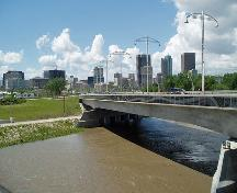 General view of The Forks, showing viewscapes east and west along course of the Assiniboine River, 2008.; Winnipeg Skyline from Bridge, Adam DeClercq, 2008.