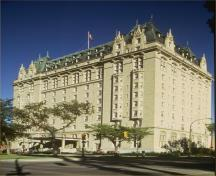 General view of Fort Garry Hotel, showing its high-quality materials, including: smooth, Indiana limestone cladding; a grey granite base; and copper roofing, 1985.; Parks Canada/Parcs Canada 1985 (HRS 1026)