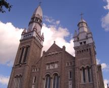 The two tall asymmetrical spires of St. Brigid's Church.; RHI2, 2009
