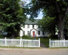 Showing setting of house with spacious grounds and picket fence; City of Charlottetown, Natalie Munn, 2005
