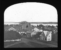 "Shows new Wesleyan Church under construction in the 1860s.  The ""L"" shaped extension immediately to the left of the new church is the current 21-23 Prince Street building.; PEI Public Archives and Records Office, Smith Alley Collection, Accession #2702/29"