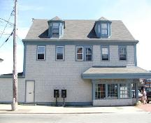 Side elevation, including Scottish dormers, Owl Drug Store, Dartmouth, Nova Scotia, 2005.; HRM Planning and Development Services, Heritage Property Program, 2005.