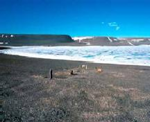General view of the grave mounds and cairns at the Franklin wintering camp at Beechey Island Sites, 1977.; Parks Canada Agency / Agence Parcs Canada, D. Hardie, 1977.