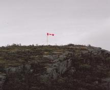 View of flag on top of Peter's Finger, New Perlican, NL. Photo taken 2011. ; © Heritage New Perlican 2011