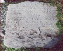 The original sandstone gravemarker from John Parot's Grave Municipal Heritage Site, Old Perlican, NL. Photo taken 2004.; © Baccalieu Trail Heritage Corporation 2006