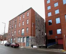 The building which shelters Crow's Nest, on Water street. The club is located on the fourth floor of the joint building on the right-hand side; Parks Canada / Parcs Canada, 2010 (Nicolas Miquelon)