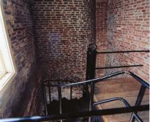 Interior view of Fisgard Lighthouse, showing the the quality and workmanship of original materials, particularly the original fabric cast iron staircase in the tower, and the interior brickwork.; Ian Doull, Parks Canada Agency, 2010  / Ian Doull, Agence Parcs Canada, 2010
