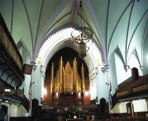 View of the interior of St. James United Church emphasizing the surviving original interior features at the north end of the sanctuary which typify Methodist churches of the period, including the communion rail, the pulpit platform, the pews for the choir; Parks Canada Agency / Agence Parcs Canada, D. Stiebeling