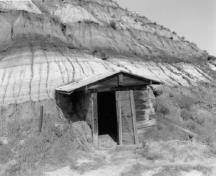 View of Atlas No. 3 Coal Mine, showing an explosives shed located at the mine entrance near the top of the hill , 1998.; Agence Parcs Canada / Parks Canada Agency, W. Wylie, 1998.