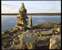 General view from Igloolik Island showing an inukshuk.; Parks Canada Agency / Agence Parc Canada