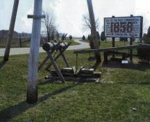Williams-dug oil well near the museum with a three-pole derrick at the First Commercial Oil Field National Historic Site of Canada, 2005.; Agence Parcs Canada / Parks Canada Agency, A. Roos, 2005.