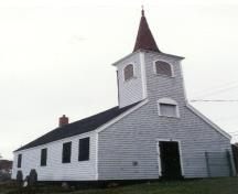 General view of Little Dutch (Deutsch) Church, showing its small scale, rectangular massing, pitched roof and belfry with polygonal spire, 1995.; Parks Canada Agency / Agence Parcs Canada, 1995.