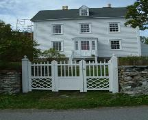 View of front facade of Lakeview, Brigus, NL showing the wooden gate, stone wall and Brigus porch.; © HFNL 2007