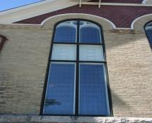 Detail of tall nave window and brickwork of St. Andrew's United Church, Manitou, 2011.; Historic Resources Branch, Manitoba Culture, Heritage and Tourism, 2011