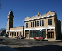 Context view of main facade and attached Town Office of the Virden Municipal Building and Auditorium, Virden, 2005; Historic Resources Branch, Manitoba Culture, Heritage & Tourism, 2005