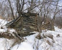 South side of the Doukhobor Dugout House near Blaine Lake in winter, 2006; Government of Saskatchewan, Bernard Flaman, 2006