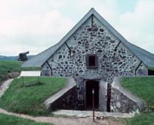 Facade of the South Powder Magazine showing the single square headed door, 1994.; Parks Canada/ Parcs Canada. Jérôme, J.P, 1994.