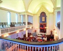 View of the interior of the Congregation Emanu-el Temple, showing the gallery and railings, 1994.; Parks Canada Agency / Agence Parcs Canada, J. Butterill, 1994.