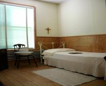 Interior view of a nun's personal quarters at the Convent of the Sisters of the Holy Names of Jesus and Mary, St. Pierre-Jolys, 2005; Historic Resources Branch, Manitoba Culture, Heritage & Tourism, 2005