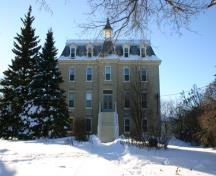 View of the east elevation of the Convent of the Sisters of the Holy Names of Jesus and Mary, St. Pierre-Jolys, 2005; Historic Resources Branch, Manitoba Culture, Heritage & Tourism, 2005