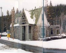 Façade of Building 3, showing the half-timbering featured on the upper half of the building and the use of locally quarried split fieldstone in irregular courses for the exterior walls, 1985.; Parks Canada Agency / Agence Parcs Canada, 1985.