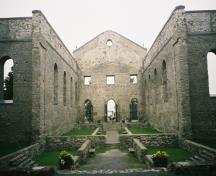 Interior of St. Raphael's Church Ruins showing walls of the nave, transepts and foundation, 2004.; OHT, 2004