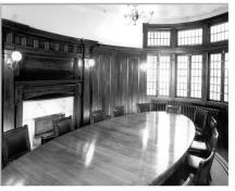 Oval Boardroom after restoration, showing wood paneling and bay window; OHT