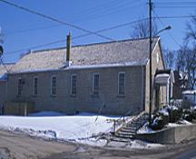 Side view of the Former Elora Drill Shed, showing its regularly placed multi-pane sash windows and stone construction, 1995.; Parks Canada Agency / Agence Parcs Canada, J. Butterill, 1995.