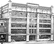 Historic exterior view of the Trapp Block; Jim Wolf