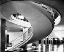 Ovoid grand staircase in foyer.; City of Ottawa Archives, 2001, Archives de la ville de Ottawa, 2001.