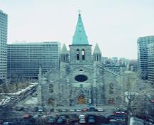 View of the exterior of St. Patrick's Basilica, showing the quality of construction materials, including its limestone masonry, stone decoration and copper roof, 1995.; Parks Canada Agency / Agence Parcs Canada, P. St. Jacques, 1995.