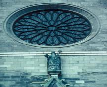 Detail view of St. Patrick's Basilica, showing its French Gothic Revival rose window, 1995.; Parks Canada Agency / Agence Parcs Canada, P. St. Jacques, 1995.