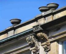 Detail of a Granville Block building, showing the Italianate design element of the ornate moldings on the eaves, 2005.; Parks Canada Agency / Agence Parcs Canada, 2005.