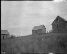 Historic photograph showing the Hudson's Bay Company Posts at Fort McPherson, ca. 1920, from which only remains are left today.; Library and Archives Canada | Bibliothèque et Archives Canada, MIKAN 3327875.